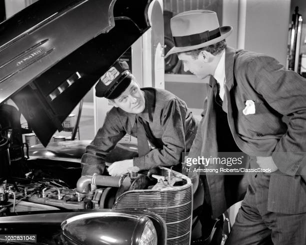 1930s 1940s AUTO MECHANIC EXPLAINING PROBLEM WITH ENGINE TO CAR OWNER