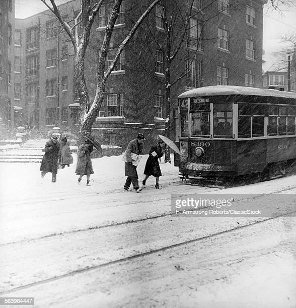 1930s 1940s CITY WINTER SCENE PEDESTRIANS CROSSING STREET SNOW TROLLEY CAR
