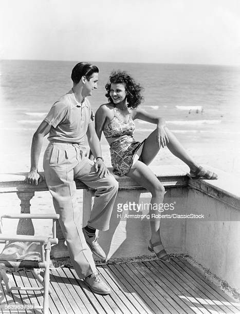 1930s 1940s COUPLE ON HOTEL DECK FLIRTING FLORIDA USA
