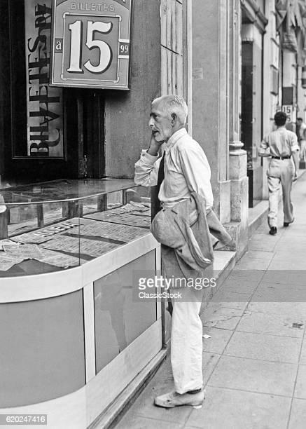 1930s 1940s ELDERLY MAN STANDING IN FRONT OF A LOTTERY SHOP HAVANA CUBA