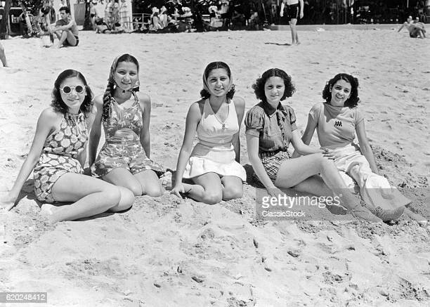 1930s 1940s FIVE SMILING WOMEN IN BEACH CLOTHES SITTING IN THE SAND LOOKING AT CAMERA LA PLAYA HAVANA CUBA