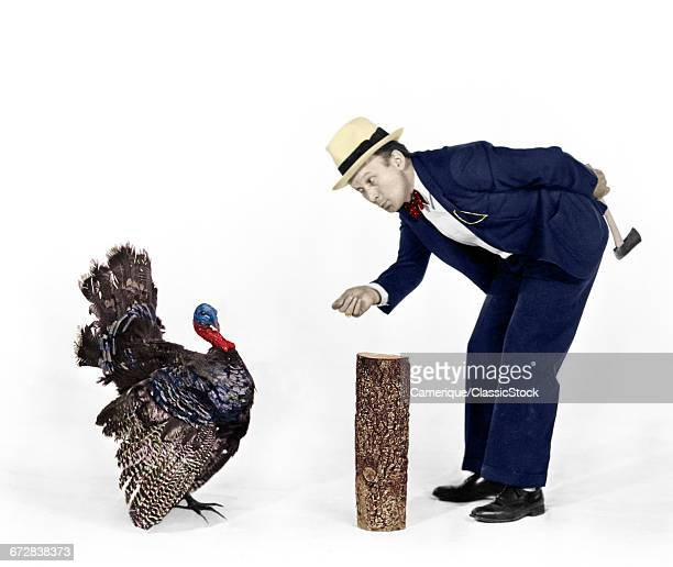 1930s 1940s MAN CHARACTER WITH HATCHET TRYING TO CATCH A THANKSGIVING TURKEY