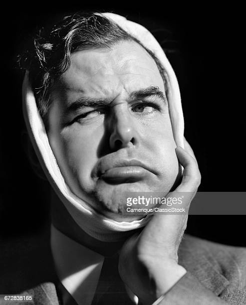 1930s 1940s MAN IN PAIN WITH SWOLLEN JAW BANDAGED