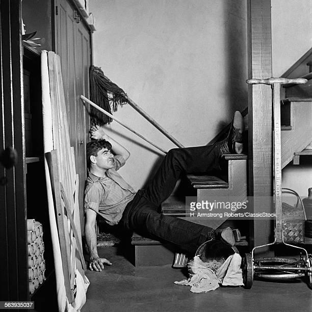1930s 1940s MAN LYING AT...