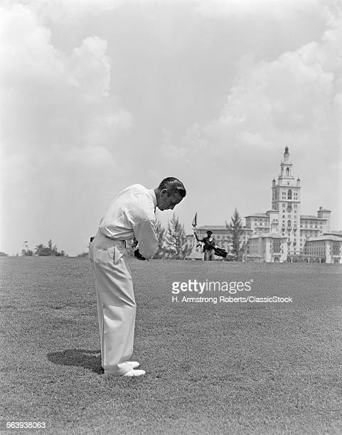1930s 1940s MAN PLAYING GOLF GOLFING BILTMORE HOTEL MIAMI FLORIDA MEN TRAVEL VACATION SPORT SPORTS