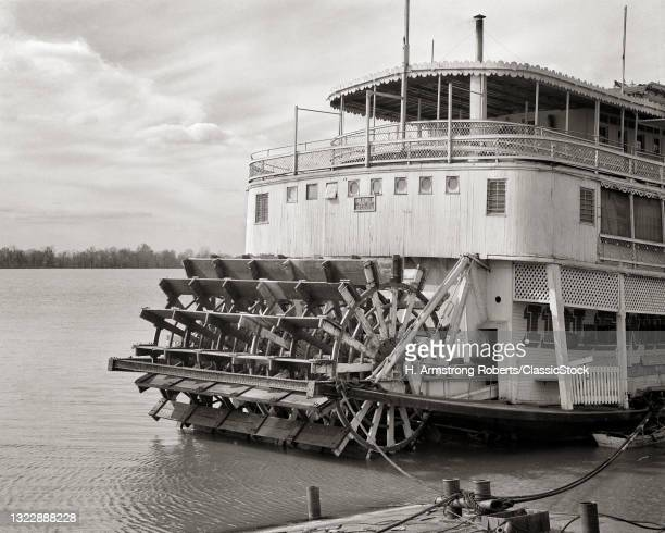 1930s 1940s Paddle Wheel Passenger Packet River Boat Tied To Shore On Mississippi River Alton Illinois USA.