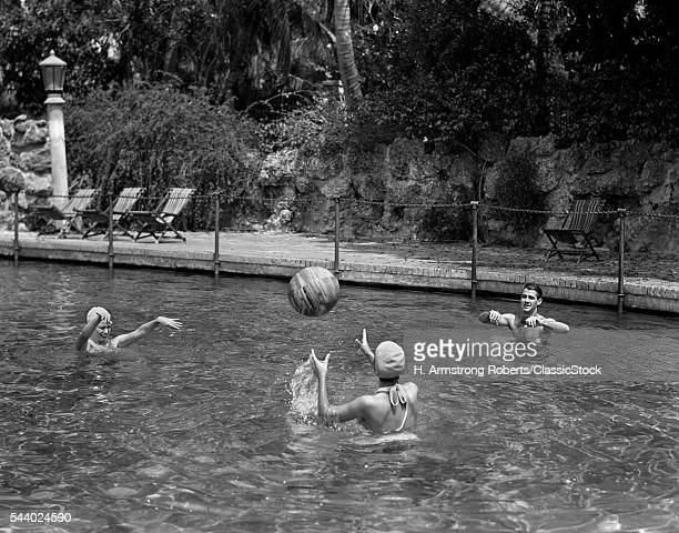 1930s 1940s PLAYING WITH A BEACH BALL IN SWIMMING POOL