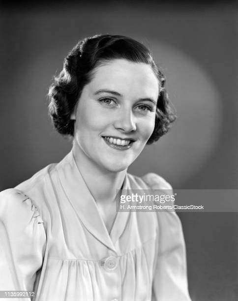 1930s 1940s PORTRAIT OF SMILING WOMAN WEARING BUTTON DOWN BLOUSE LOOKING AT CAMERA