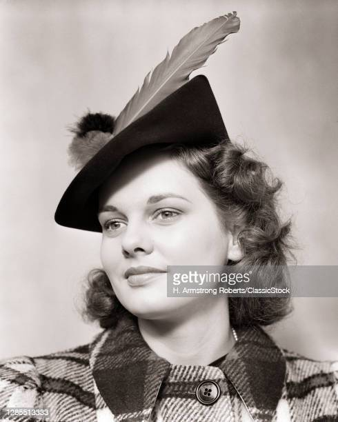 1930s 1940s Portrait Smiling Young Woman Teen Wearing Woolen Plaid Coat And Jaunty Hat With Large Feather