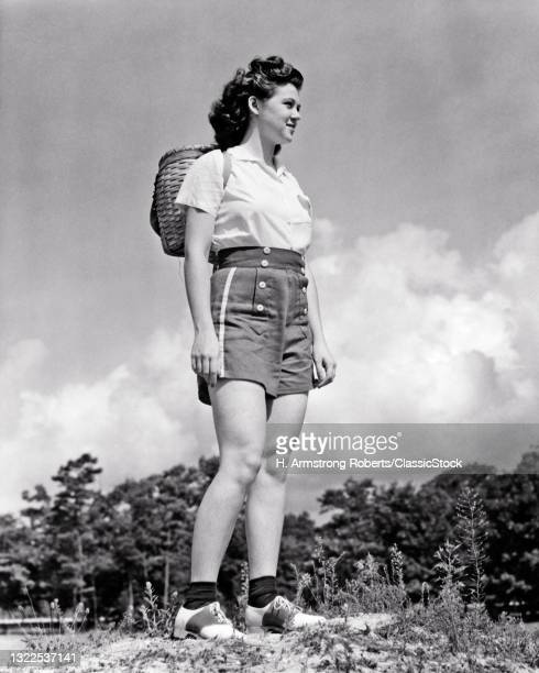 1930s 1940s Smiling Athletic Teen Girl Hiking Wearing Split Wood Basket Backpack Summer Shorts Saddle Oxford Shoes.