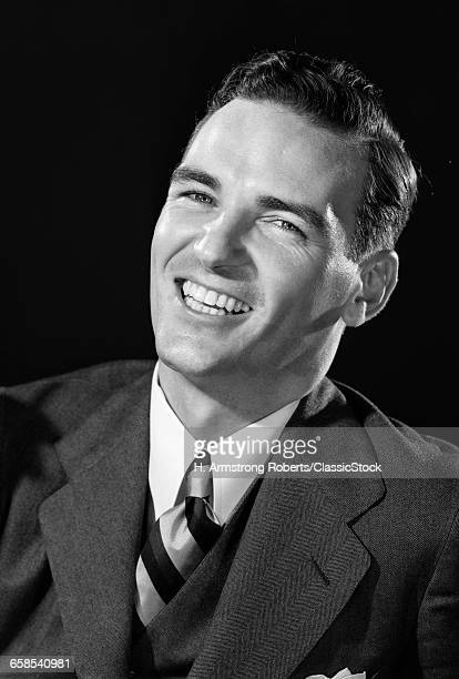 1930s 1940s SMILING LAUGHING MAN WEARING SUIT AND STRIPED NECKTIE