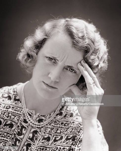 1930s 1940s UNHAPPY BLONDE WOMAN HAND TO FOREHEAD HEADACHE PAINED FACIAL EXPRESSION
