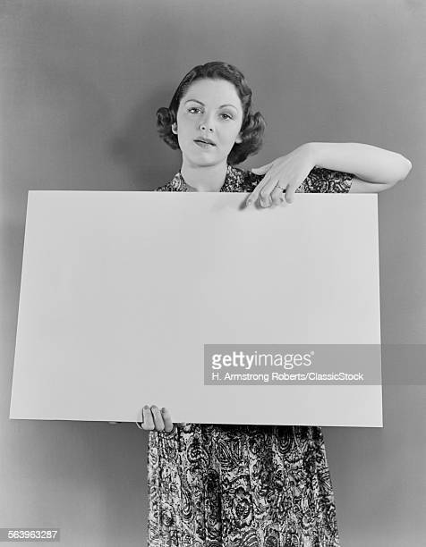 1930s 1940s WOMAN HOLDING...