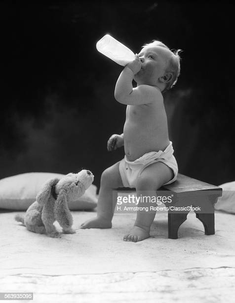 1930s BABY SEATED ON STOOL...