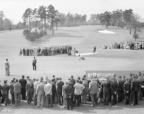 Bobby Jones and Jimmy Demaret putt on the 9th green during a 1930's Masters Tournament at Augusta National Golf Club in Augusta Georgia