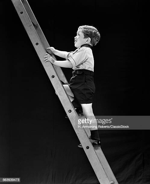 1930s BOY CHILD CLIMBING TALL LADDER