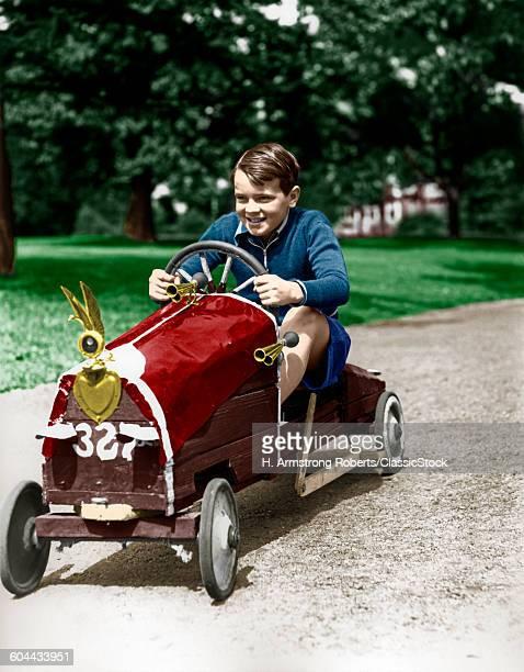 1930s BOY DRIVING HOME.