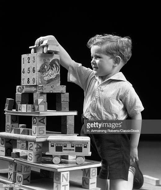 1930s BOY PLAYING WITH...