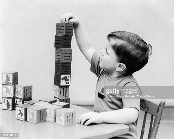 1930s BOY STACKING PLAYING...