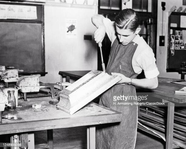 1930s Boy Student Learning To Solder Tin Building Decorative Trim In Industrial Arts High School