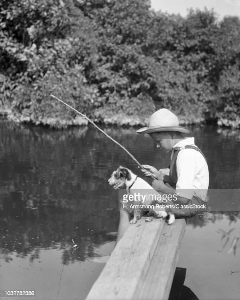1930s BOY WEARING STRAW...