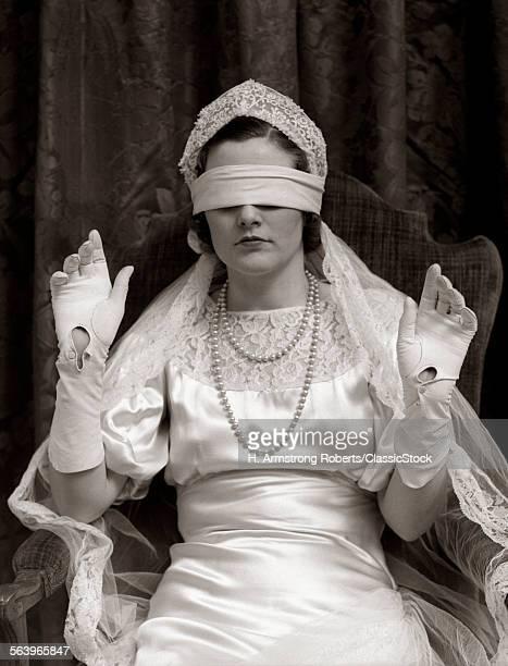 1930s BRIDE WEARING BLINDFOLD