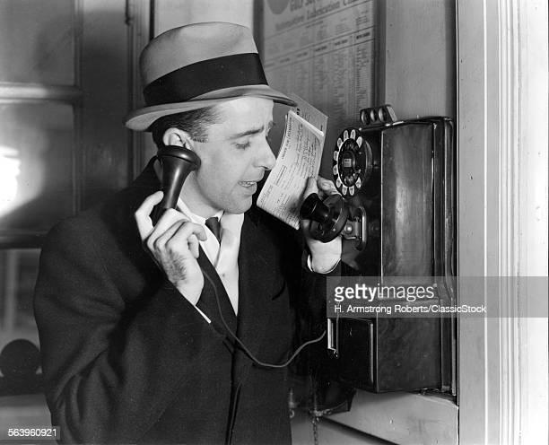 1930s BUSINESSMAN IN HAT...