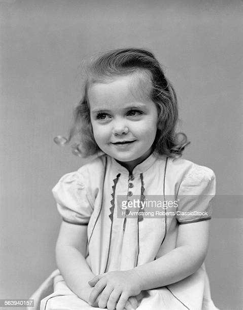 1930s CHILD LITTLE GIRL POSING SITTING WITH HANDS TOGETHER