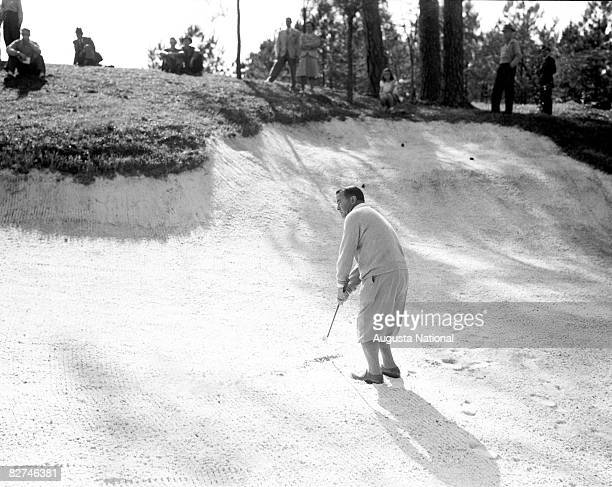 Gene Sarazen pitches from bunker during a Masters Tournament at Augusta National Golf Club in the 1930s in Augusta Georgia