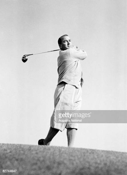 Gene Sarazen takes a swing shot from a hill during a Masters Tournament at Augusta National Golf Club in the 1930s in Augusta Georgia