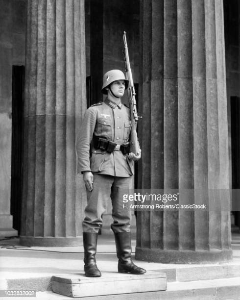 1930s GERMAN SOLDIER AT ATTENTION RIFLE ON SHOULDER STANDING GUARD STEPS TOMB OF UNKNOWN SOLDIER BERLIN GERMANY