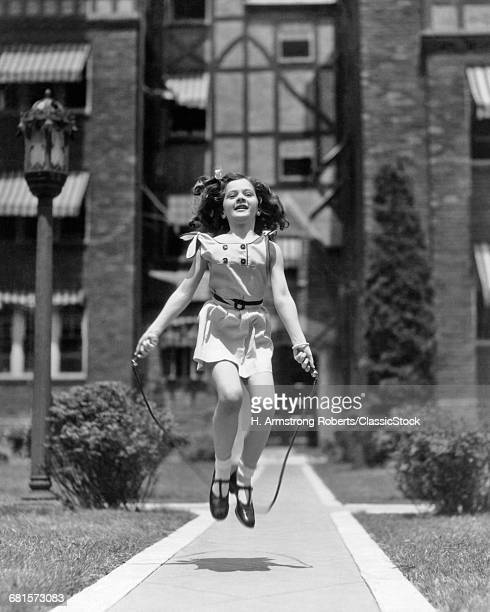 1930s GIRL JUMPING ROPE ON...