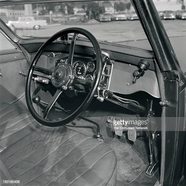 1930s Hispano Suiza V12 Interior view showing righthand drive steering wheel pedals shifter hand brake gauges switches and radio