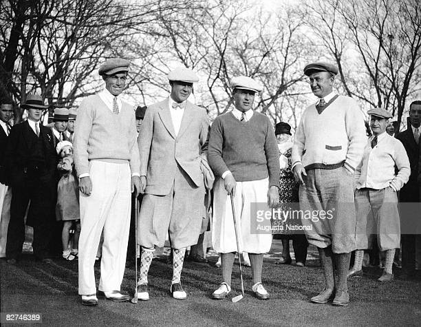 Johnny Farrell Grantland Rice Bobby Jones and Ty Cobb stand together during a Masters Tournament at Augusta National Golf Club during the 1930s in...