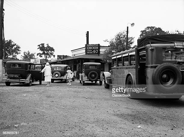 1930s JULY 5 1937 WOMAN GIRL CARS BUS IN ROADSIDE DINER RESTAURANT PARKING LOT SOUTHERN FRIED CHICKEN 40 CENTS CROTON NY USA