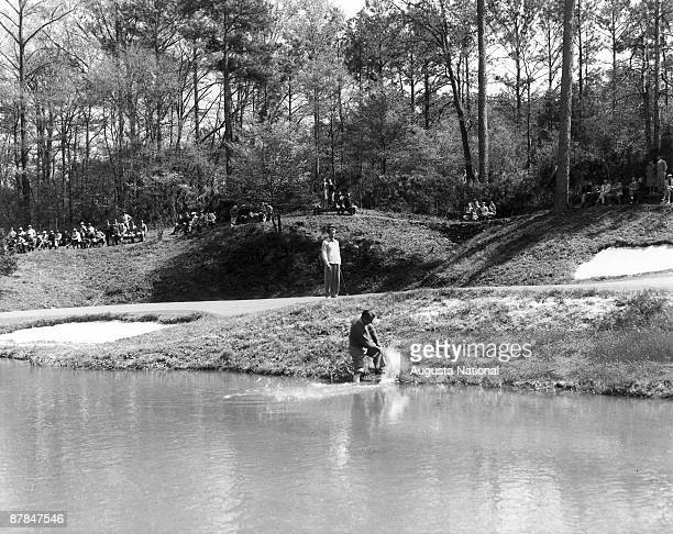 Ky Lafoon attempts to blast from the edge of Rae's Creek onto the 12th green during a 1930s Masters Tournament at Augusta National Golf Club in April...