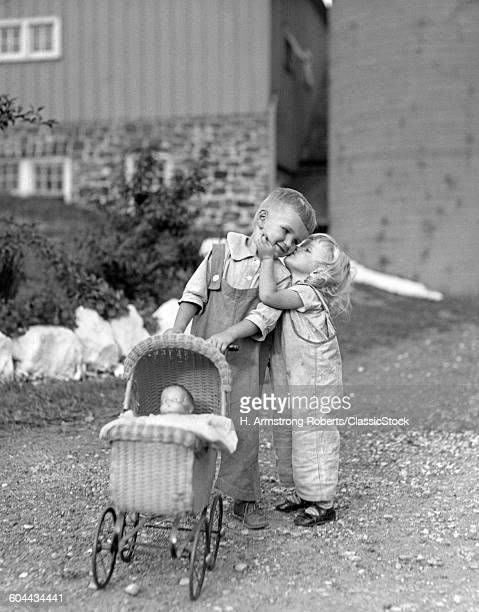 1930s LITTLE GIRL KISSING.