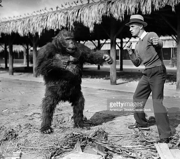 1930s MAN FIGHTING...