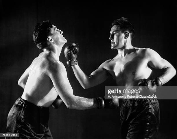 1930s MAN IN BOXING MATCH...