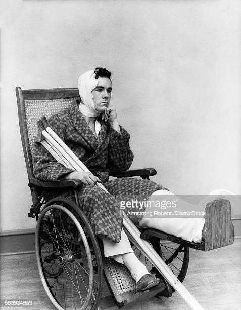 1930s MAN IN WHEELCHAIR...