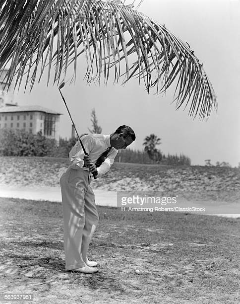 1930s MAN PLAYING GOLF GOLFING NEAR BILTMORE RESORT HOTEL CORAL GABLES FLORIDA