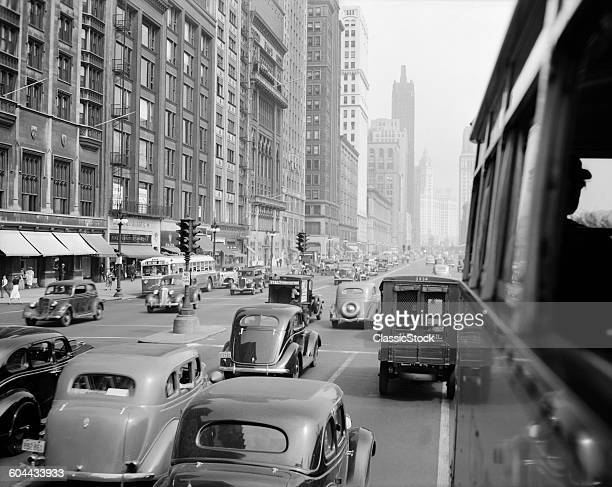 1930s MORNING TRAFFIC ON.