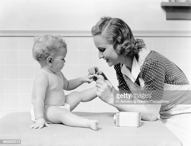 1930s MOTHER TOUCHING BABY TOES FINGERS THIS LITTLE PIGGY NURSERY RHYME