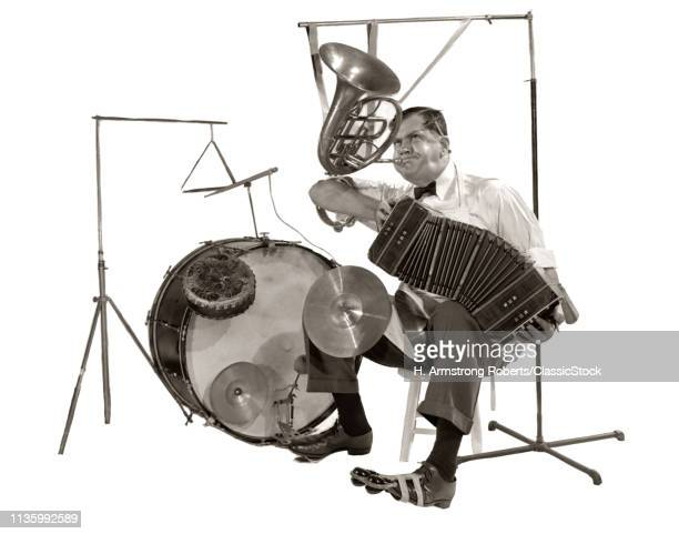 1930s ONEMANBAND PLAYING ACCORDION FRENCH HORN DRUMS