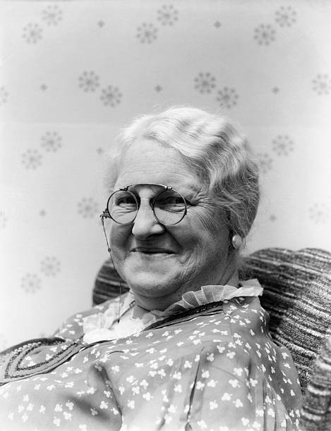 1930s PORTRAIT OF ELDERLY WHITE HAIR WOMAN SMILING WEARING PINCE-NEZ GLASSES