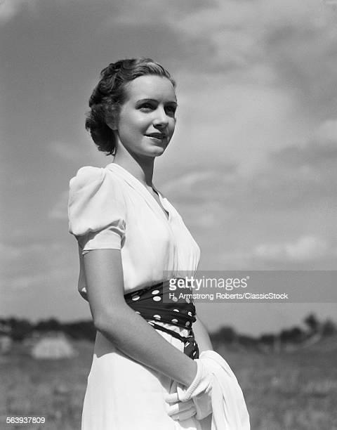 1930s PORTRAIT OF YOUNG WOMAN SMILING WHITE DRESS POLKA DOT BELT FASHION