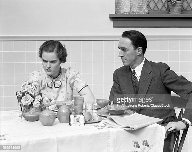 1930s QUARRELING COUPLE AT...