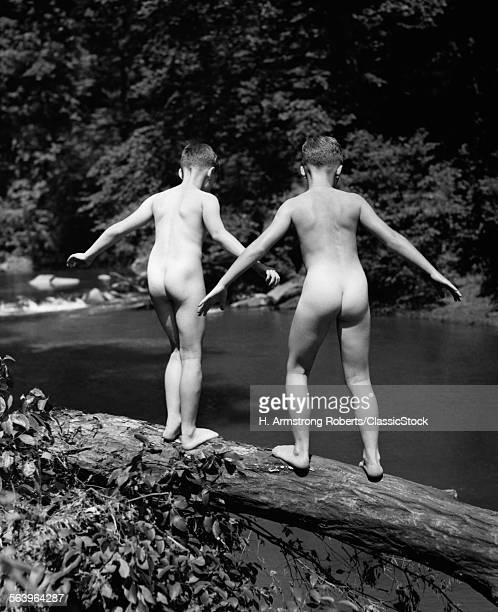 1930s REAR VIEW PAIR NAKED SKINNY DIPPING BOYS GETTING READY TO JUMP OFF LOG INTO CREEK