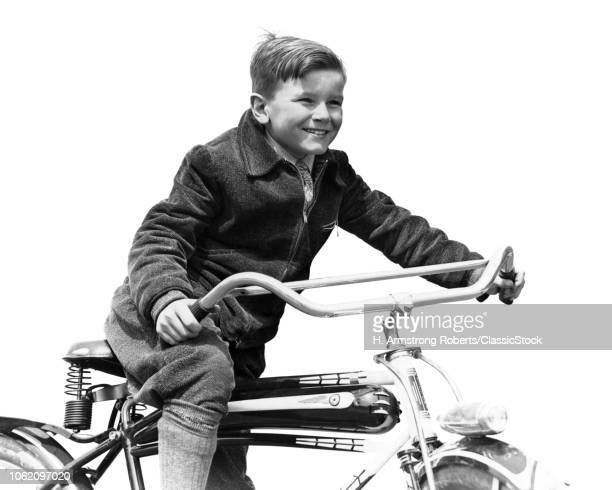 1930s SMILING BOY IN AUTUMN CORDUROY JACKET KNEE SOCKS AND PANTS PEDALING HEAVY AMERICAN SPACE SHIP DESIGN STYLE BICYCLE