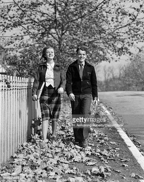 1930s TEEN COUPLE WALKING...